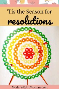 Image of a bulls-eye or target with arrows in it made from Lifesavers candy for the blog post Tis the season for resolutions ModernRetroWoman.com