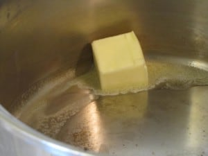 Melt butter in a soup pot.